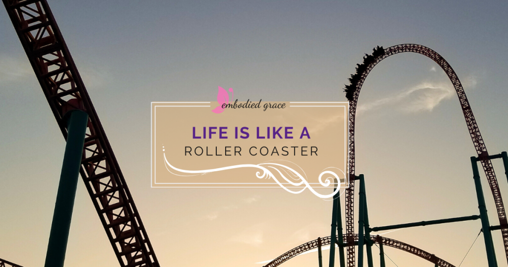 large roller coaster with evening sky background